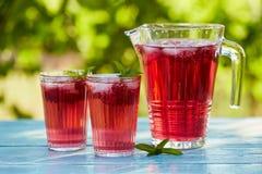 Red lemonade with raspberry Stock Photos