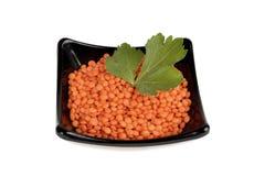 Red lentil in black ceramic bowl, Royalty Free Stock Images