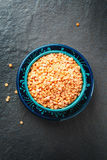Red Lentil Halves in a Wooden Spoon Royalty Free Stock Images