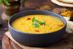 Red lentil Indian soup with flat bread Masoor dal Royalty Free Stock Photo