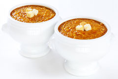 Red Lentil Soup. Spicy red lentil soup with croutons in lion head bowls Stock Photography