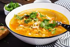 Red lentil soup with chicken meat and vegetables close-up on the table. Healthy food stock images
