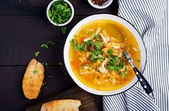 Red lentil soup with chicken meat and vegetables close-up on the table. Healthy food. Top view royalty free stock images