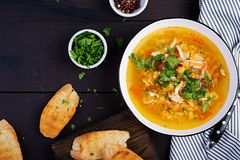 Red lentil soup with chicken meat and vegetables close-up on the table. Healthy food. Top view stock image