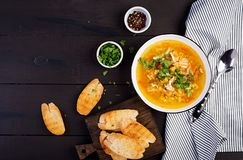 Red lentil soup with chicken meat and vegetables close-up on the table. Healthy food. Top view stock photo