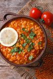 Red lentil soup with lemon and parsley vertical top view Royalty Free Stock Image