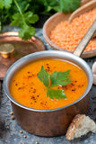 Red lentil soup with pepper and spices in saucepan, vertical Royalty Free Stock Photography