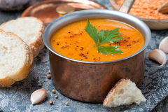 Red lentil soup with spices in a copper saucepan, close up Royalty Free Stock Image