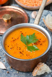 Red lentil soup with spices in a copper saucepan, top view Stock Photo