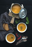 Red lentil soup with spices, herbs, bread in a Royalty Free Stock Images