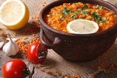 Red lentil soup with vegetables close-up on the table. horizonta Stock Photography