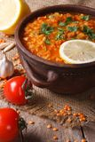 Red lentil soup with vegetables close-up on the table. Vertical Stock Photography