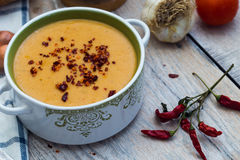 Red lentil soup with vegetables on the wooden background Stock Photography