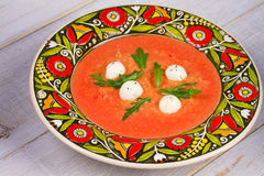 Red lentil and tomato soup with mozzarella. Stock Image