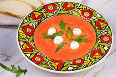Red lentil and tomato soup with mozzarella. Royalty Free Stock Photos