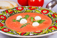 Red lentil and tomato soup with mozzarella. Stock Images