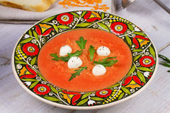 Red lentil and tomato soup with mozzarella. Royalty Free Stock Photography
