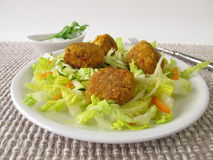 Red lentils balls on salad Stock Photos