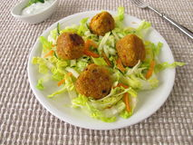 Red lentils balls on salad Royalty Free Stock Images