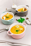 Red lentils cream soup with rusks in small serving pots or bowl. Royalty Free Stock Photography