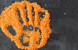 Red lentils with hand imprint Royalty Free Stock Images