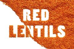 Red lentils inscription on white. Top view legumes Stock Photos