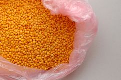 Red Lentils in a plastic bag. Organic Product. Vegetarian food royalty free stock images