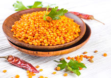 Red lentils pepper and parsley stock photos