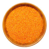Red lentils in wooden bowl Stock Photo