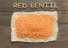 Red lentils with wooden word Royalty Free Stock Photo