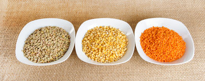 Red lentils, yellow lentils and green dried lentils Stock Photography