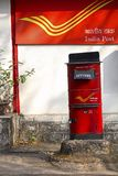 Red letter box with background of India Post, Pune University campus, Pune. Red letter box with background of India Post, Pune University campus at Pune Stock Photography