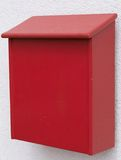 Red letter box made of wood. Bright red post box made of wood royalty free stock photo