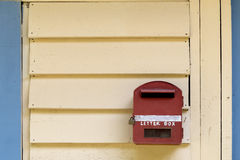 Red letter box on wood background Stock Photos