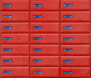 Red letter boxes. A background from red boxes with blue stripes on them royalty free stock photo