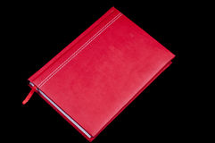 Red letter diary. On the black background Royalty Free Stock Photos