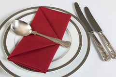 Red letter napkins on fancy table royalty free stock images