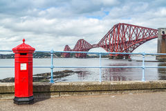 Red letterbox and Firth of Forth rail bridge Stock Photos