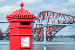 Red letterbox and Firth of Forth rail bridge Royalty Free Stock Photos