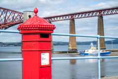 Red letterbox and Firth of Forth rail bridge Stock Images