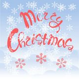 Red lettering Merry Christmas on blue sky background, white cloud, snow-flakes Royalty Free Stock Images