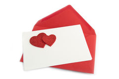 Red letters on card with hearts Royalty Free Stock Photos