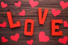 Red letters love on brown wooden background. LOVE word stock photos