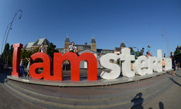 Red letters in the park in centre of Amsterdam. The letters Amsterdam in front of the rijksmuseum in Amsterdam the Netherlands http://www.iamsterdam.com/en-GB/ Royalty Free Stock Photography