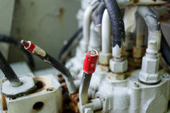 Red lever on industrial machine Royalty Free Stock Images