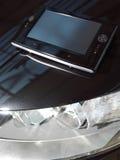 Red-libro negro en el coche l Fotografía de archivo libre de regalías