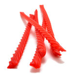 Red Licorice. Stacked on top of one another against an all white background Stock Images