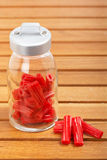 Red licorice on glass jar Royalty Free Stock Photos