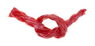 Red licorice tied in knot Royalty Free Stock Image