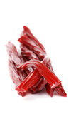 Red Licorice on white with a shallow DOF Royalty Free Stock Photo